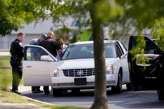 After initially responding to an armed robbery call for Old National Bank, 140 South Creasy lane, Lafayette Police talk with a disgruntled customer in the parking lot of the bank, Tuesday, Sept. 10, 2019 in Lafayette.