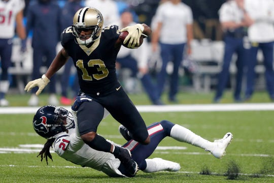 New Orleans Saints wide receiver Michael Thomas (13) tries to break a tackle by Houston Texans cornerback Bradley Roby (21) in the first half of an NFL football game in New Orleans, Monday, Sept. 9, 2019.