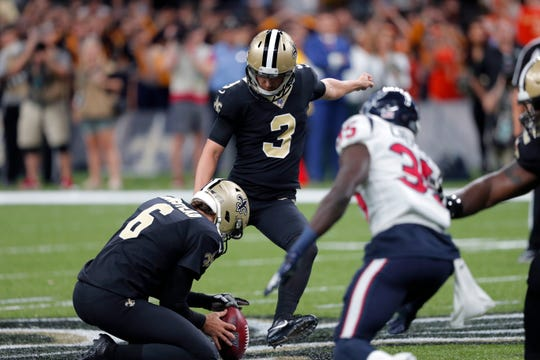New Orleans Saints kicker Wil Lutz (3) kicks a 58-yard field goal as Thomas Morstead (6) holds, at the end of regulation, in the second half of an NFL football game against the Houston Texans in New Orleans, Monday, Sept. 9, 2019. The Saints won 30-28.