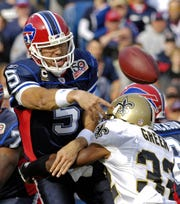 Buffalo Bills quarterback Trent Edwards gets rid of the ball as he is sacked by New Orleans Saints cornerback Jabari Greer during the first half of an NFL football game in Orchard Park, N.Y. on Sunday, Sept. 27, 2009. Buffalo lost 27-7.