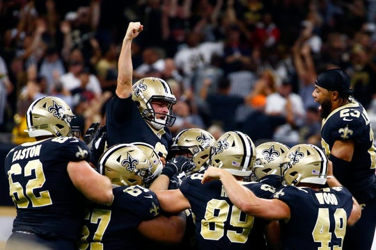 New Orleans Saints kicker Wil Lutz celebrates his game-winning 58-yard field goal at the end of regulation in the second half of an NFL football game against the Houston Texans in New Orleans, Monday, Sept. 9, 2019. The Saints won 30-28.