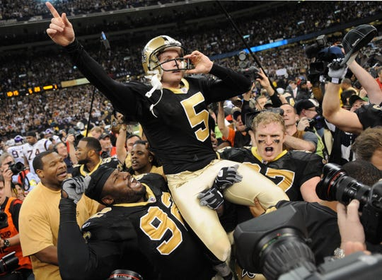 New Orleans Saints PK Garrett Hartley (5) is carried off the field after kicking the game winning field goal at the Louisiana  Superdome as the New Orleans Saints defeated the  Minnesota Vikings during the NFC Championship game