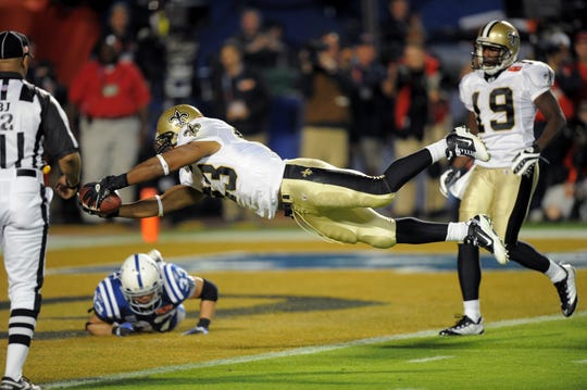 New Orleans Saints' Pierre Thomas stretches across the goal line for a touchdown in the third quarter at Super Bowl XLIV Sunday, February 7, 2010 in Miami.