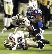 New Orleans Saints safety Chris Reis (39) recovers an on-side kick as Indianapolis Colt Cody Glenn (52) hits Roman Harper (41) from behind during the second half of the NFL Super Bowl XLIV football game in Miami, Sunday, Feb. 7, 2010.