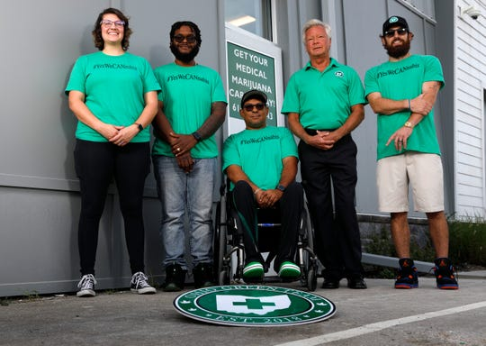 Ohio Green Team employees (left to right): Kelsey Logan, Dariko Caldwell, Fred English, Dr. Steven Schneider and Ryan Brown stand outside the company's medical marijuana clinic in Greenfield Township.