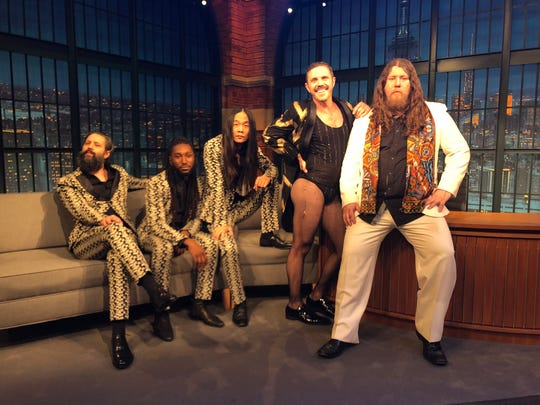 "Performing with Jake Shears on  ""Late Night with Seth Meyers"" on NBC are left to right  Mark Palgy (VHS or Beta), Stephen Gladney, Craig Pfunder (VHS or Beta), Jake Shears and MMJ drummer Patrick Hallahan."
