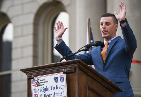 Michigan Speaker of the House Lee Chatfield, R-Levering, speaks Tuesday, Sept. 10, 2019, at the Second Amendment March at the State Capitol.  Last January, Chatfield had to pay a $1,960 fine to the Transportation Security Administration when he inadvertently carried a loaded and unregistered handgun through a security checkpoint at Pellston Regional Airport last July.