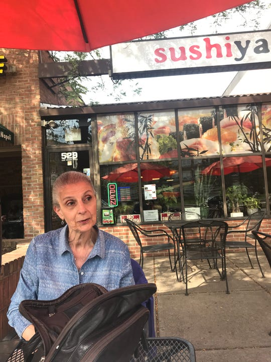 Joan Otto, 83, of East Lansing Tuesday, Sept. 9, 2019, recalls the purse snatching that happened at the same table at Sushiya along Grand River in East Lansing. A Good Samaritan helped get her purse back.