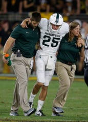 Jake Hartbarger is helped off the field against Arizona State on Sept. 8. Ross D. Franklin/AP Michigan State punter Jake Hartbarger is helped off the field during the second half against Arizona State, Sept. 8, 2018, in Tempe, Ariz.