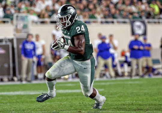 Aug 30, 2019; East Lansing, MI, USA; Michigan State Spartans running back Elijah Collins (24) runs the ball during the first half of a game against the Tulsa Golden Hurricane at Spartan Stadium. Mandatory Credit: Mike Carter-USA TODAY Sports