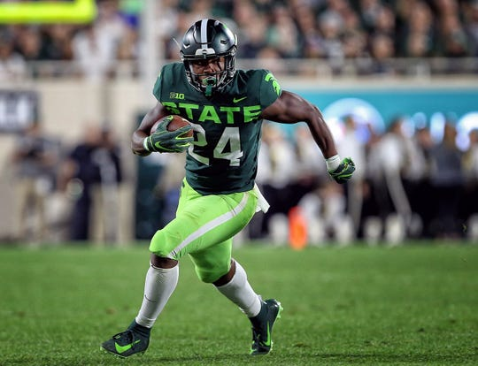 Sep 7, 2019; East Lansing, MI, USA; Michigan State Spartans running back Elijah Collins (24) runs the ball during the 1st half of a game against the Western Michigan Broncos at Spartan Stadium.