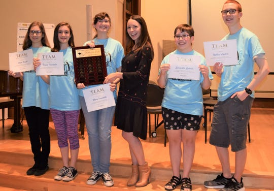 Manitowoc Public Library Battle of the Books team for 2019, from left: Aeryn Kozak, Teresa Iannitello, Mary Iannitello, competition emcee and former Miss Wisconsin Courtney Pelot, Samantha Czekala and Nathan Luckow.