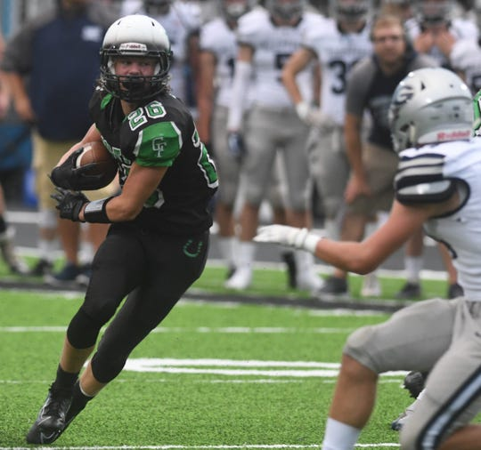 Clear Fork's Ashton Lyon looks for running room during the Colts' Week 2 loss to Granville at home. He will look to lead his team to victory at Lexington on Friday night.