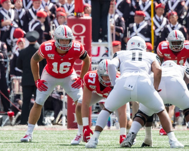 Lexington grad Cade Stover (16), Ohio's Mr. Football in 2018, saw his first action at linebacker for Ohio State last Saturday, making two tackles in the 42-0 win over Cincinnati.