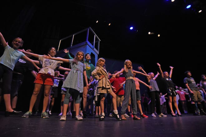 The cast of Frozen Jr. rehearses Tuesday night at the Renaissance Theatre.