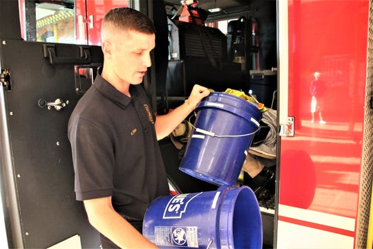 Marion Firefighter Andrew Niles said each department truck is equipped with two buckets, one for clean hoods and one for used hoods. The used hoods are washed back at the station after each fire run. Each hood is rated for 100 washes, according to the National Fire Protection Association.