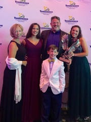 Mike Miller, the owner of Patrick's, was named Restaurateur of the Year by the Tennessee Hospitality & Tourism Association. Miller (center) is pictured with his wife Tonya, daughters Kallen and Kathryn and son Malachi.