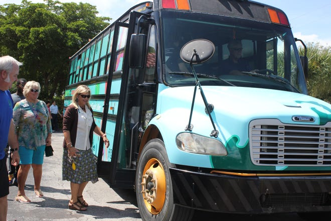 Cindy Love-Abounader, CEO of the Y, prepares to head back to the campus in the re-wrapped bus.