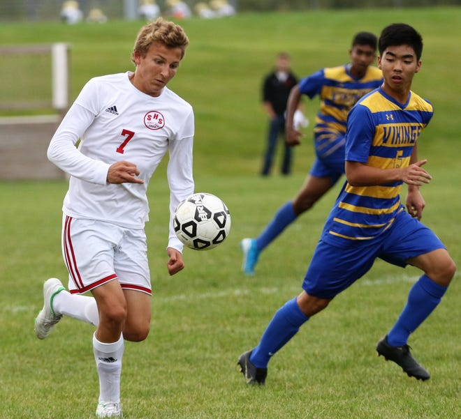 Shorewood forward Denis Krioutchenkov brings the ball up the field while watched by New Berlin West defender Zion Wang on Sept. 9, 2019.