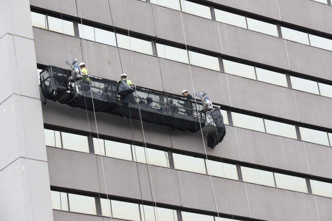 Work continues on the exterior of the Hyatt Recency hotel in downtown Milwaukee. The hotel was sold in 2018. Michael Sears/Milwaukee Journal Sentinel