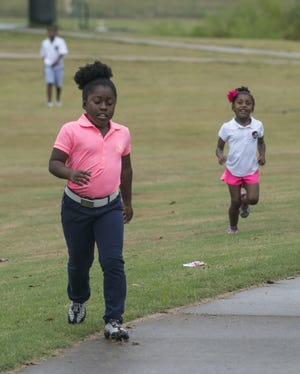 On Sept. 21, 2015, Lauryn Olivia Leonard, 8, of Montgomery and her siblings, Quincy Ahlias Leonard, 10, and London Leonard, 5, play at Gateway Park. Lauryn, now 12, finished second in the girls 12-13 age division in the Southeastern Regional Drive, Chip & Putt Championship on Sunday in Atlanta. London, now 8, finished sixth in the in the girls 7-9 age division.
