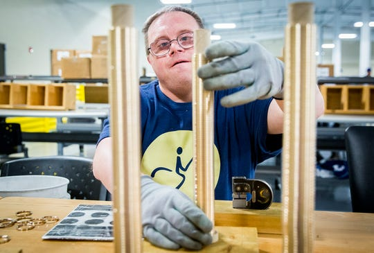 Hillcroft client Josh Scamihorn works a shift inspecting brass fittings on Hillcroft Service's new production floor.
