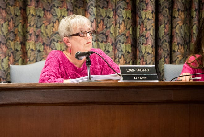 Linda Gregory, a member of the Muncie City Council, listens to officials during the monthly meeting of Council on Sept. 9 at city hall. Gregory was the deciding vote on the formation of an environmental impact committee.