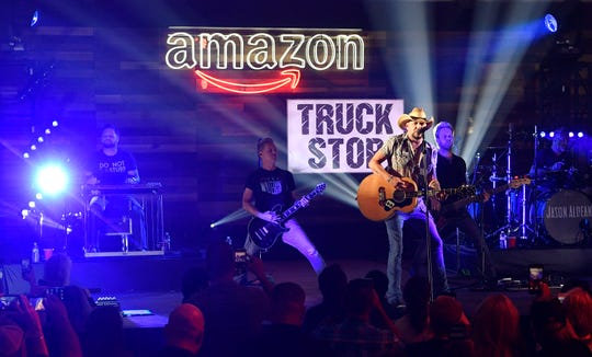 Jason Aldean performs at an Amazon-created pop-up truck stop in the parking lot of Nissan Stadium to celebrate National Truck Driver Appreciation Week on Monday.