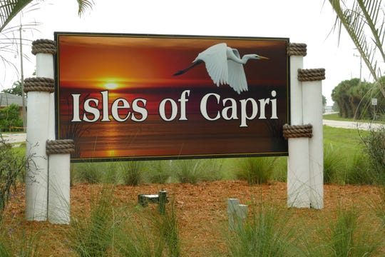 A sign welcomes drivers to Isles of Capri in Collier County, Florida, on Sept. 9.