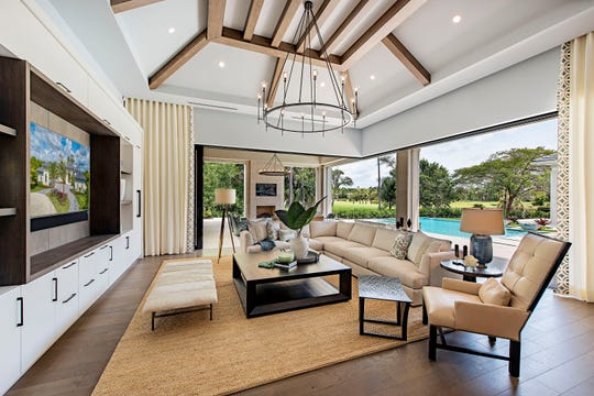 The leisure room of The Coquina model features pocket sliding doors to bring Naples' natural radiance indoors.