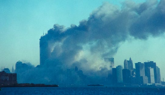 The South Tower collapses around 10 a.m. on Sept. 11, 2001, in Lower Manhattan. Hijacked commercial airliners crashed into the towers.
