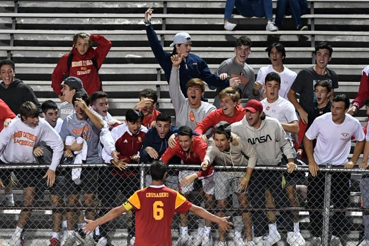 Bergen Catholic's Chris Barile (6) celebrates with fans after his second goal to tie the game against Don Bosco on Monday, Sept. 9, 2019, in Ramsey.