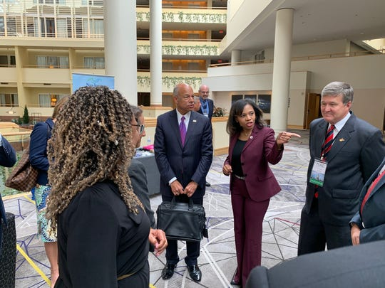 Former Homeland Security Secretary Jeh Johnson, left, meets with New Jersey Secretary of State Tahesha Way at a cybersecurity exercise on Tuesday, Sept. 10, 2019.