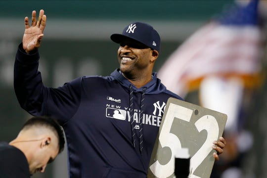 New York Yankees' CC Sabathia waves during a ceremony in his honor before a baseball game against the Boston Red Sox in Boston, Sunday, Sept. 8, 2019.