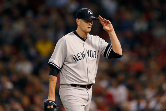 New York Yankees' James Paxton salutes fans as he walks to the dugout after being relieved during the seventh inning of a baseball game against the Boston Red Sox in Boston, Monday, Sept. 9, 2019.
