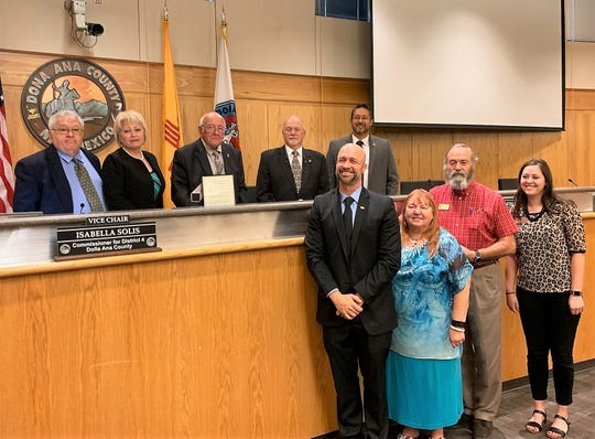 From left, the Doña Ana County Board of Commissioners, New Mexico Workforce Solutions Secretary Bill McCamley and representatives from the Gospel Rescue Mission and Las Cruces Community Foundation pose during the commissioners' meeting on Tuesday, September 10, 2019.