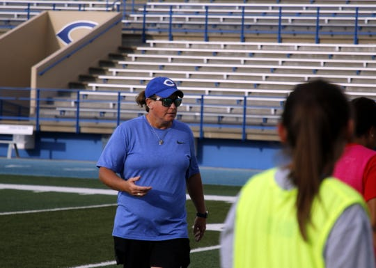Cavegirls head coach Misty Long discusses tactics during practice on Sept. 9, 2019. The Cavegirls are currently 7-0-1 and the No. 1 ranked team in Class 5A in New Mexico.