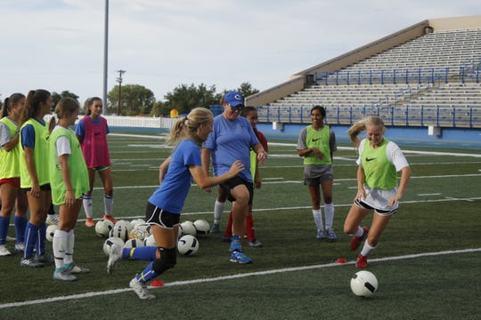 Carlsbad girls coach Misty Long, center starts off an explosiveness drill between Jessica Munroe, left, and Emily Hervol, right, during practice on Sept. 9, 2019. The Cavegirls are currently 7-0-1 and the No. 1 ranked team in Class 5A in New Mexico.