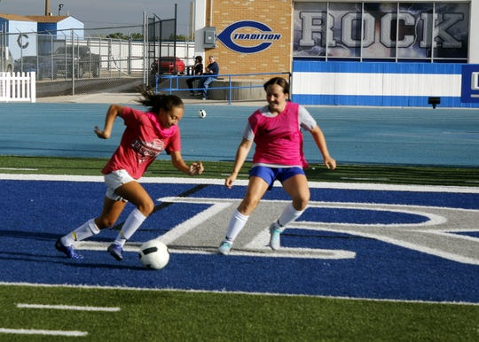 Carlsbad's Baylee Molina sprints to the goal while Morgan Brannan defends during practice on Sept. 9, 2019. The Cavegirls are currently 7-0-1 and the No. 1 ranked team in Class 5A in New Mexico.