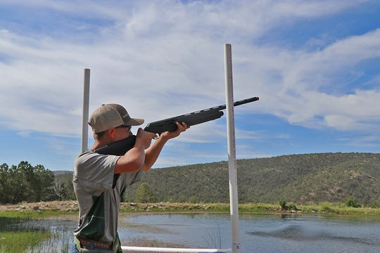 A competitor at the annual clay shoot takes aim.