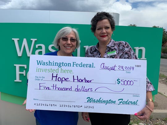 Executive Director of Hope Harbor, Lorna Fike receives a $5,000 grant from Washington Federal, given by Maria Misquez, Washington Federal Assistant Vice President and Branch Manager on Aug. 29.