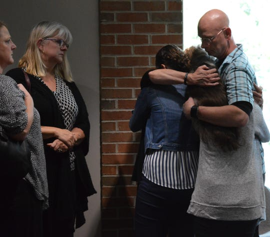 Danielle Stislicki's family embraces Tuesday, Sept. 10, 2019, after a judge binds over Floyd Galloway's premeditated murder case to Oakland County Circuit Court.