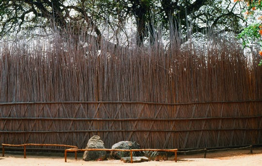 A traditional African reed fence offers great height, tight density and is difficult to climb over.