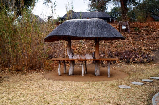 These beautiful little thatched tables are permanent accents as well as useful places for a buffet or outdoor dining.