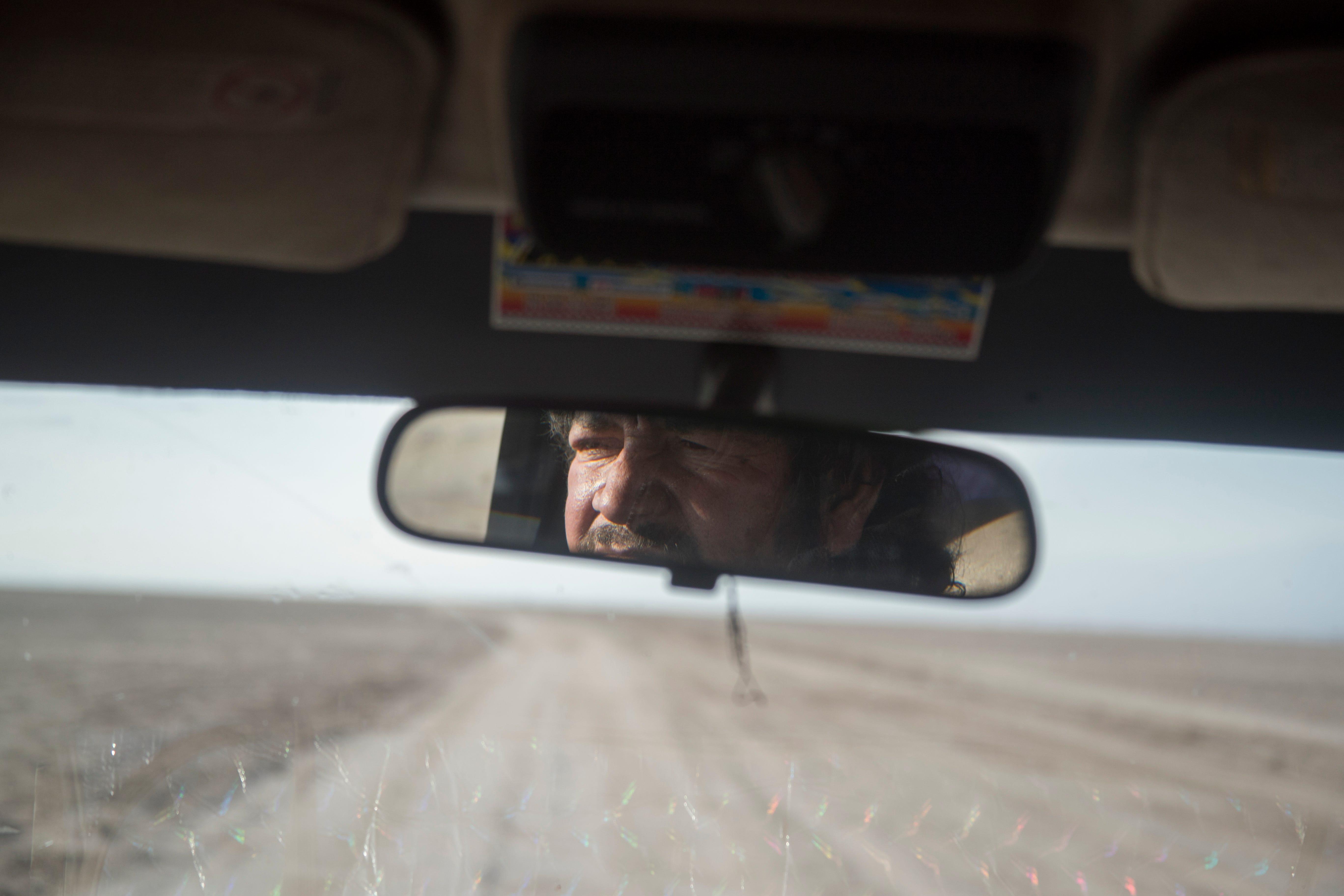 Jesús Antonio Muñoz drives through Laguna Salada, where residents warn of quicksand and swamps.
