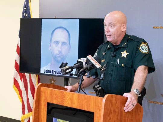 Santa Rosa County Sheriff Bob Johnson talks Tuesday about the arrest of John Travis Palmer in connection to the death of his roommate in March 2015.
