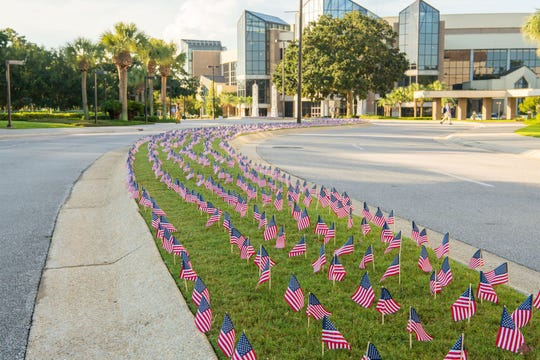 "The ""9-11 Never Forget Project"" is a student-led initiative at Pensacola Christian College that began in 2018. Students place 2,977 flags on campus to commemorate the lives lost on Sept. 11, 2001."