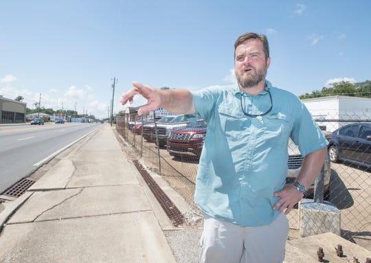 Josh Fields, general manager of Cliff Fields Motors, talks Tuesday about his concerns over FDOT's proposals for pedestrian safety improvements in Brownsville.