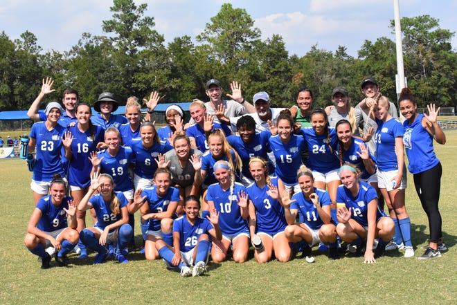 The UWF women's soccer team celebrates the 500th win of head coach Joe Bartlinski's coaching career in September 2019 at the UWF Soccer Complex.