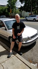 Tony Kastelic poses with his sliver Volvo, the first car he's owned in 25 years because of his battle with alcohol and heroin addiction.